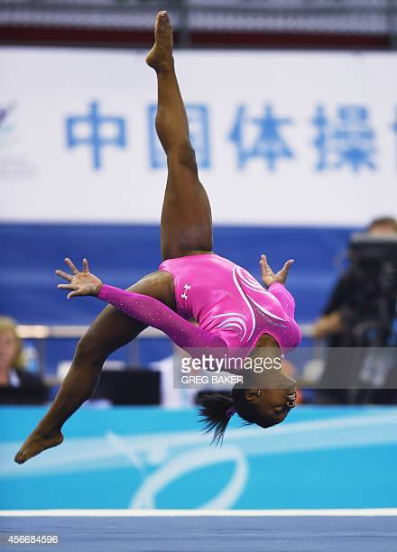Simone Biles of the US performs a floor routine during the women's qualifications at the Gymnastics World Championships in Nanning in China's...
