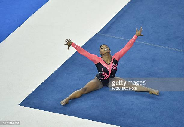 Simone Biles of the US performs during the women's floor exercise final at the gymnastics world championships in Nanning on October 12 2014 Biles won...