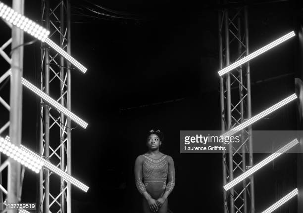 Simone Biles of the USA waits in the wings ahead of her performance on floor during the Superstars of Gymnastics at The O2 Arena on March 23 2019 in...