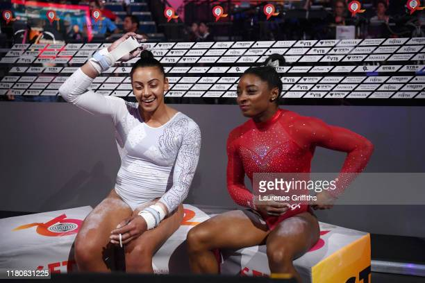 Simone Biles of United States and Rebecca Downie of Great Britain react following their routines in Women's Uneven Bars Final in the Apparatus Finals...