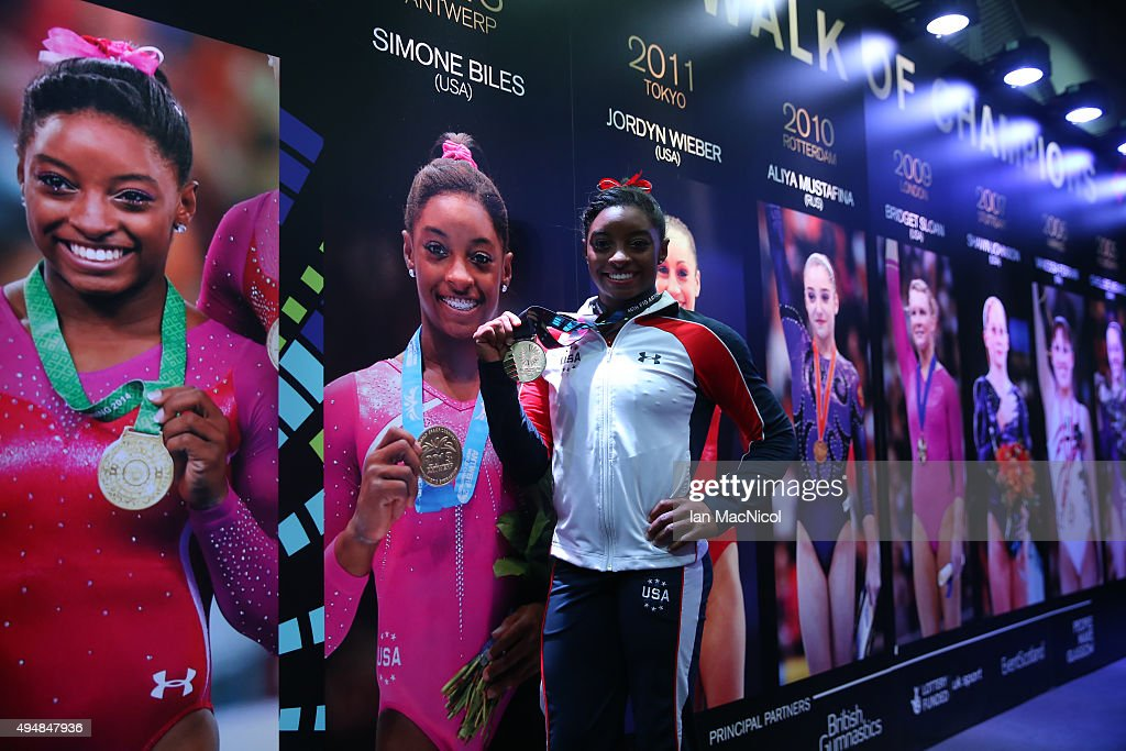 Simone Biles of United States poses with her Gold medal in the Hall of Champions during day seven of World Artistic Gymnastics Championships at The SSE Hydro on October 29, 2015 in Glasgow, Scotland.