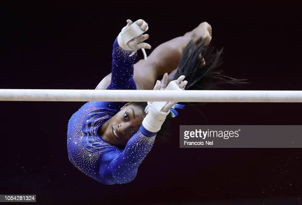 Simone Biles of USA competes in the Women's Uneven Bars Qualification during day three of the 2018 FIG Artistic Gymnastics Championships at Aspire...