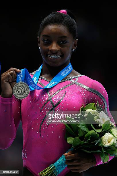 Simone Biles of USA poses after winning the Bronze medal in the Women's balance beam final on Day Seven of the Artistic Gymnastics World...