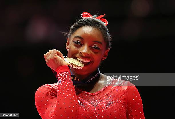 Simone Biles of USA poses with the Gold medal after winning the AllAround Final on day seven of the 2015 World Artistic Gymnastics Championships at...