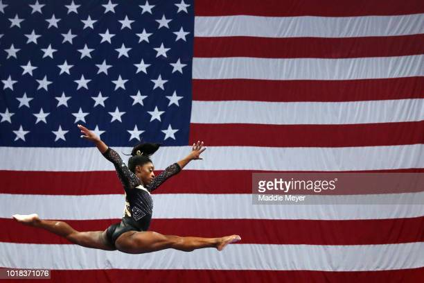 Simone Biles warms up on the balance beam during Day 2 of the US Gymnastics Championships 2018 at TD Garden on August 17 2018 in Boston Massachusetts
