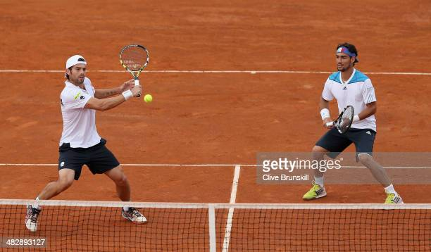 Simone Bolelli and Fabio Fognini of Italy in action against Andy Murray and Colin Fleming of Great Britain during day two of the Davis Cup World...