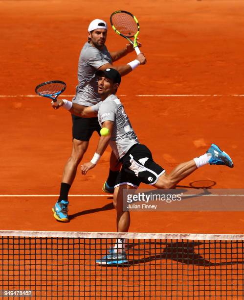 Simone Bolelli and Fabio Fognini of Italy in action against Bob and Mike Bryan of USA in the doubles semi final during day seven of the ATP Masters...