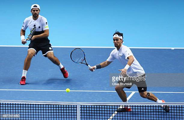 Simone Bolelli and Fabio Fognini of Italy in action in their men's doubles match against Jamie Murray of Great Britain and John Peers of Australia...