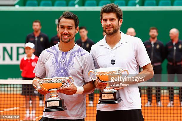 Simone Bolelli and Fabio Fognini of Italy with the runners up trophies after their loss to Bob and Mike Bryan of USA in the doubles final during day...