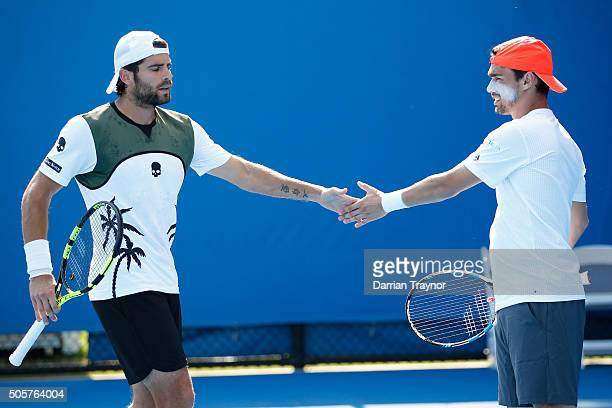 Simone Bolelli of Italy and Fabio Fognini of Italy celebrate in their first round match against Rameez Junaid of Australia and Mikhail Kukushkin of...