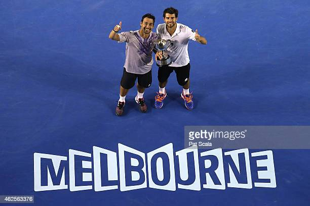 Simone Bolelli of Italy and Fabio Fognini of Italy celebrate with the winners trophy after winning their final doubles match against PierreHugues...