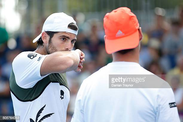 Simone Bolelli of Italy and Fabio Fognini of Italy talk tactics in their first round match against Rameez Junaid of Australia and Mikhail Kukushkin...
