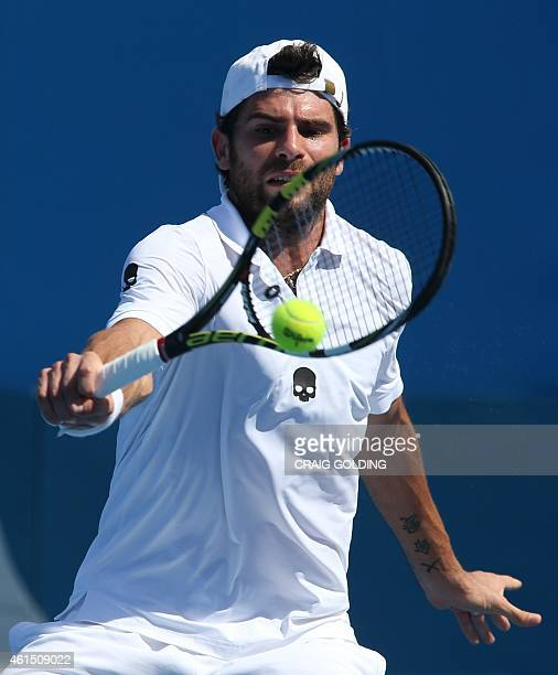 Simone Bolelli of Italy hits a return against David Goffin of Belgium during their men's singles match on day four of the Sydney International tennis...