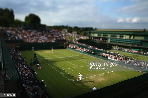 Simone Bolelli of Italy plays a backhand during his Gentlemen's Singles first round match against Grigor Dimitrov of Bulgaria on day two of the...