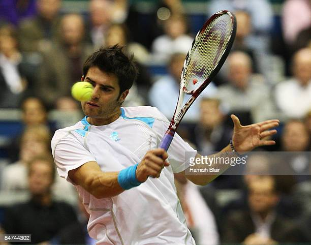 Simone Bolelli of Italy plays a backhand during his match against Rafael Nadal of Spain during day three of the ABN AMRO World Tennis Tournament at...
