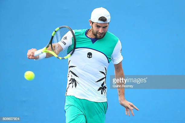 Simone Bolelli of Italy plays a backhand in his first round match against Brian Baker of the United States during day two of the 2016 Australian Open...