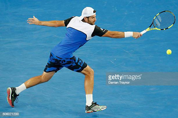 Simone Bolelli of Italy plays a backhand in his second round match against Bernard Tomic of Australia during day four of the 2016 Australian Open at...