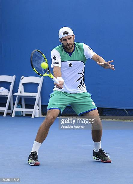 Simone Bolelli of Italy returns a shot against Brian Baker of the United States during day two of the 2016 Australian Open on January 19 2016 in...