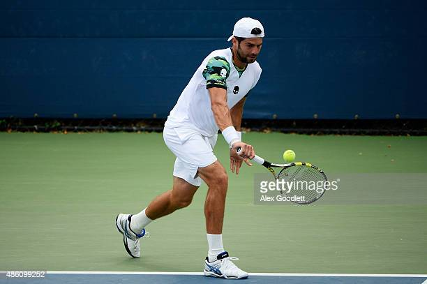 Simone Bolelli of Italy returns a shot against David Goffin of Belgium during his Men's Singles First Round match on Day One of the 2015 US Open at...
