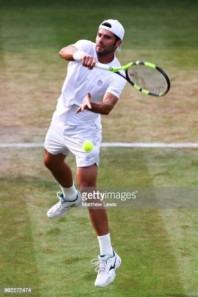 Simone Bolelli of Italy returns a shot against Fabio Fognini of Italy during their Men's Singles second round match on day four of the Wimbledon Lawn...