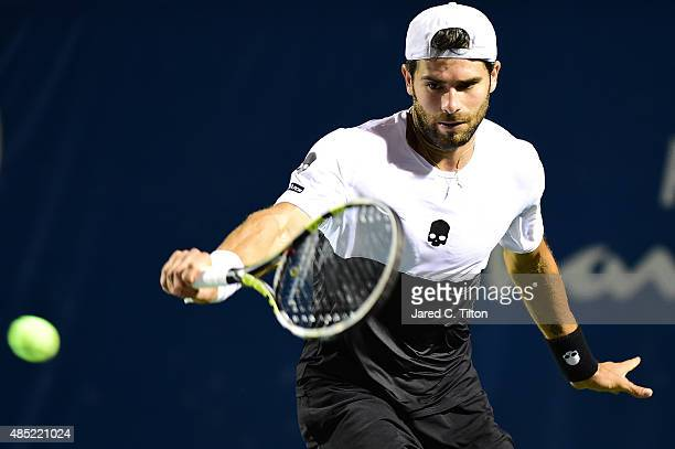 Simone Bolelli of Italy returns a shot from Sam Querrey during the second day of the WinstonSalem Open at Wake Forest University on August 25 2015 in...