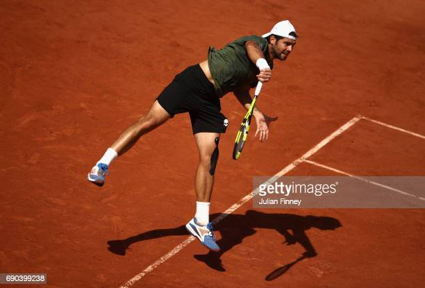 Simone Bolelli of Italy serves during the mens singles second round match against Dominic Thiem of Austria on day four of the 2017 French Open at...