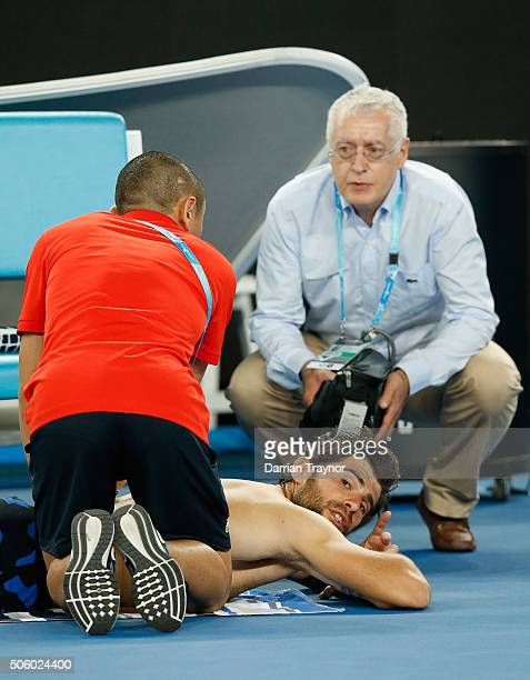 Simone Bolelli of Italy takes a medical time out in his second round match against Bernard Tomic of Australia during day four of the 2016 Australian...