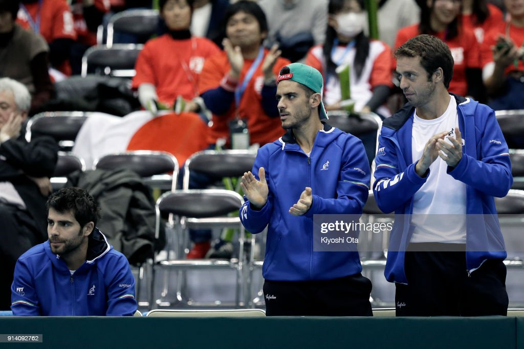 Simone Bolelli, Thomas Fabbiano and Paolo Lorenzi of Italy cheer for Fabio Fognini (unseen) of Italy as they watch his singles match against Yuichi Sugita of Japan during day three of the Davis Cup World Group first round between Japan and Italy at Morioka Takaya Arena on February 4, 2018 in Morioka, Iwate, Japan.