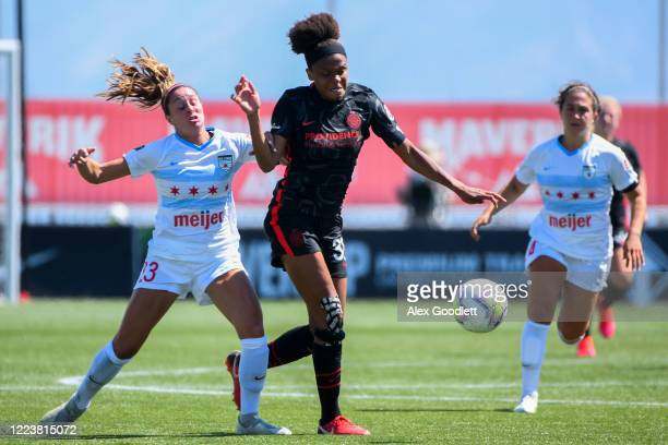 Simone Charley of Portland Thorns FC fights for the ball with Julia Bingham of Chicago Red Stars during a game in the first round of the NWSL...