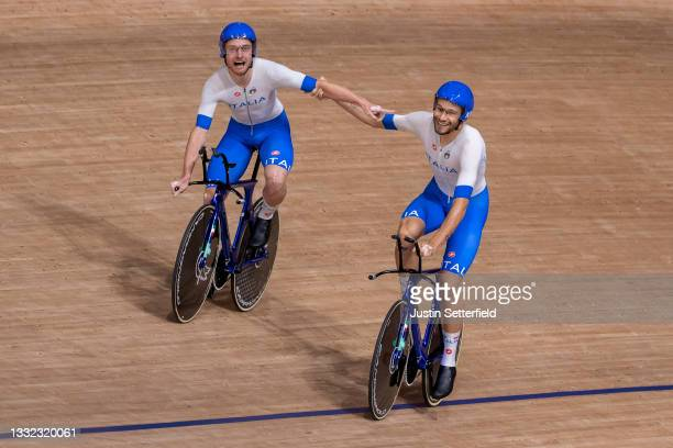 Simone Consonni and Filippo Ganna of Team Italy celebrate after setting a new World record and winning a gold medal during the Men's team pursuit...