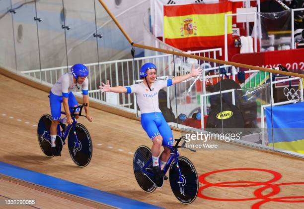 Simone Consonni and Filippo Ganna of Team Italy celebrate setting a new World record and winning a gold medal during the Men's team pursuit finals,...
