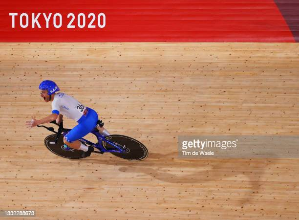 Simone Consonni of Team Italy celebrates winning a gold medal after setting a new World record during the Men's team pursuit finals, gold medal of...