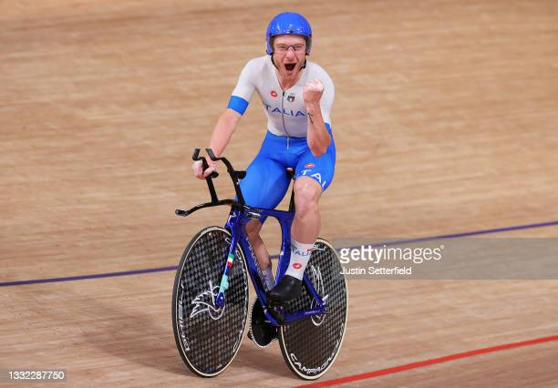 Simone Consonni of Team Italy celebrates winning a gold medal during the Men's team pursuit finals, gold medal of the track cycling on day twelve of...