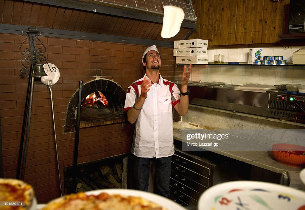 Simone Corsi of Italy and JIR Moto2 prepares the Pizza in Pizzeria Il Rustico during the pre-event 'Riders learn how to make pizza' during the Grand Prix of Italy on June 3, 2010 in Mugello Circuit near Florence, Italy.