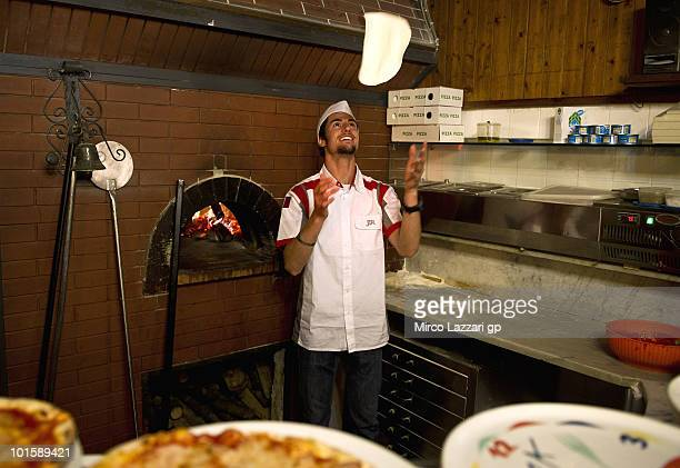 Simone Corsi of Italy and JIR Moto2 prepares the Pizza in Pizzeria Il Rustico during the preevent 'Riders learn how to make pizza' during the Grand...