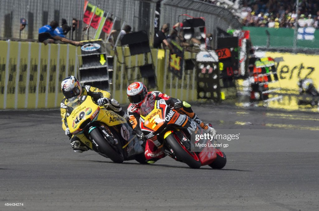 Simone Corsi of Italy and NGM Forward Racing leads Maverick Vinales of Spain and Pons HP40 in action during the MotoGP race during the MotoGp Of Great Britain - Race at Silverstone Circuit on August 31, 2014 in Northampton, United Kingdom.