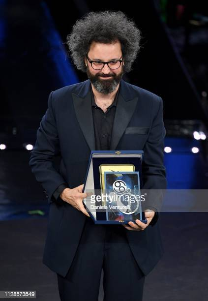 Simone Cristicchi with his prize on stage during the closing night of the 69th Sanremo Music Festival at Teatro Ariston on February 09 2019 in...