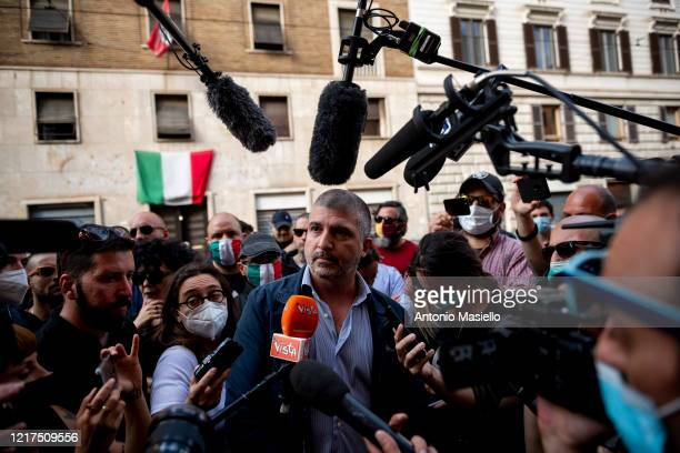 Simone Di Stefano leader of far-right political party Casapound speaks to the media during the impoundment of the Casapound headquarters, during...