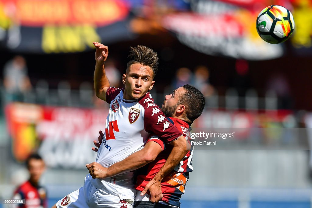 Simone Edera of Torino (L) and Davide Biraschi of Genoa vie for the ball during the serie A match between Genoa CFC and Torino FC at Stadio Luigi Ferraris on May 20, 2018 in Genoa, Italy.