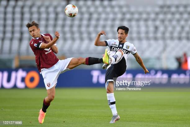 Simone Edera of Torino FC clashes with Matteo Scozzarella of Parma Calcio during the Serie A match between Torino FC and Parma Calcio at Stadio...