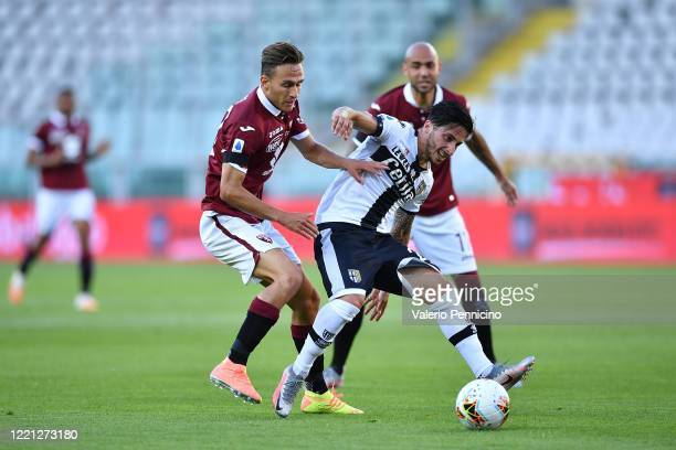 Simone Edera of Torino FC competes with Matteo Scozzarella of Parma Calcio during the Serie A match between Torino FC and Parma Calcio at Stadio...