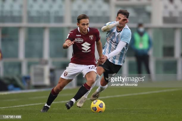 Simone Edera of Torino FC takes on Cassio Cardoselli of Virtus Entella during the Coppa Italia match between Torino FC and Virtus Entella at Stadio...