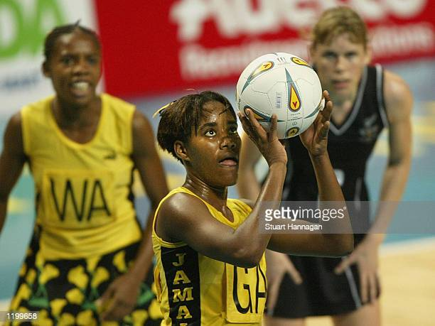 Simone Forbes of Jamaica shoots for goal during the Jamaica and New Zealand netball match at MEN stadium during the 2002 Commonwealth Games in...