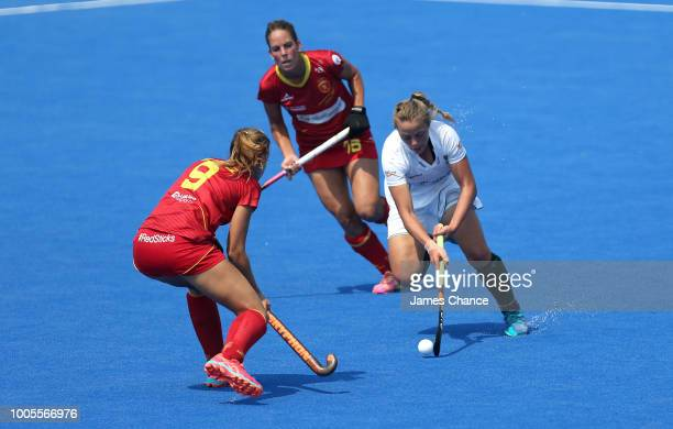 Simone Gouws of South Africa dribbles with the ball while attempting to get past Maria Lopez of Spain during the Group C game between Spain and South...