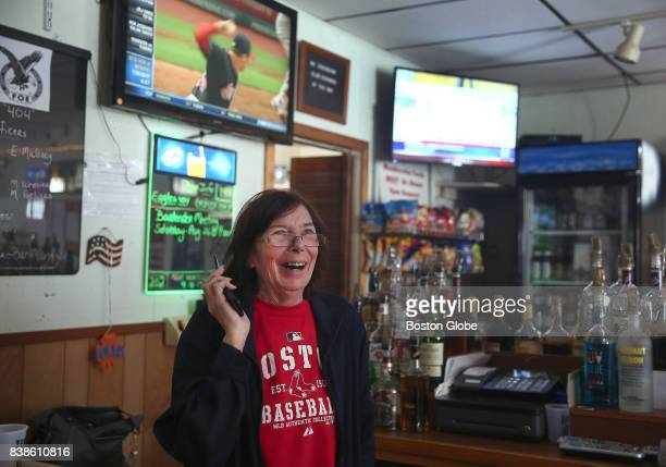 Simone Gurley volunteer bartender at The Fraternal Order of Eagles takes a call from her son as the winner of the Powerball jackpot is announced in...