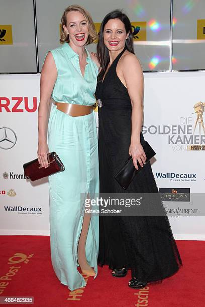 Simone Hanselmann and Elisabeth Lanz attend the Goldene Kamera 2014 at Tempelhof Airport Hangar 7 on February 1 2014 in Berlin Germany