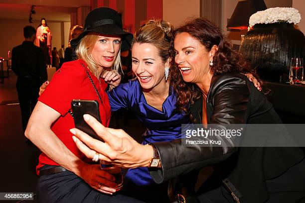 Simone Hanselmann Bettina Cramer and Anna von Griesheim attend the Tiffany Gala Host 'Streetstyle Meets Red Carpet' Event on October 08 2014 in...