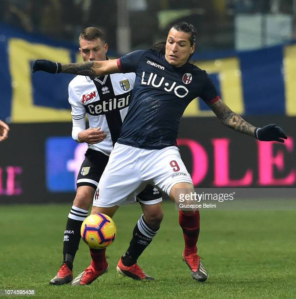 Simone Iacoponi of Parma Calcio and Federico Santander in action during the Serie A match between Parma Calcio and Bologna FC at Stadio Ennio Tardini...