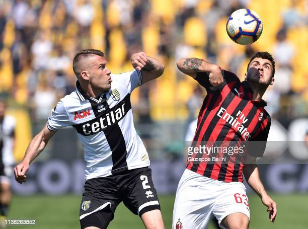 Simone Iacoponi of Parma Calcio and Patrick Cutrone of AC Milan in action during the Serie A match between Parma Calcio and AC Milan at Stadio Ennio...