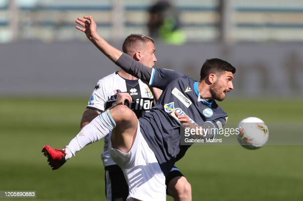 Simone Iacoponi of Parma Calcio battles for the ball with Mattia Valoti of SPAL during the Serie A match between Parma Calcio and SPAL at Stadio...